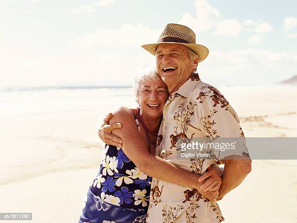 Portrait of a Senior Couple Embracing on a Beach