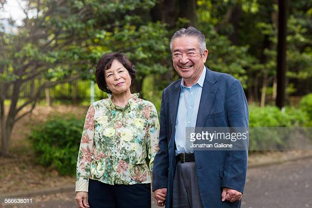 Portrait of a senior couple holding hands