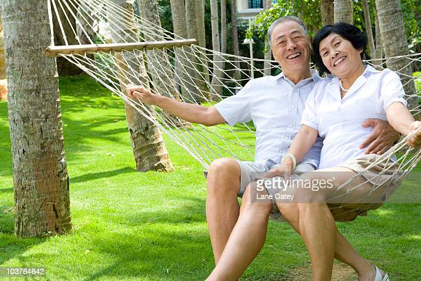 Portrait of a senior couple in a hammock