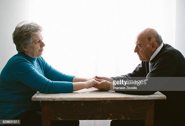portrait of a senior couple - leanintogether stock pictures, royalty-free photos & images