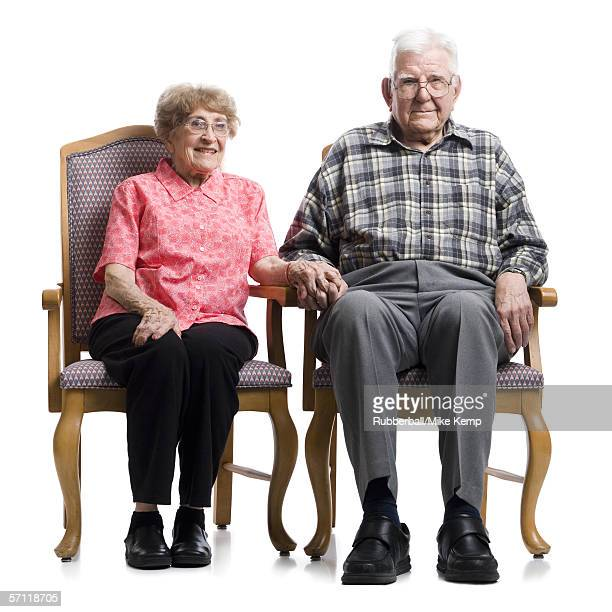 Portrait of a senior couple sitting on an armchair