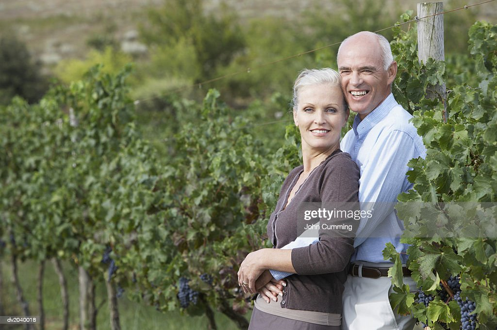 Portrait of a Senior Couple Standing in a Vineyard : Stock Photo