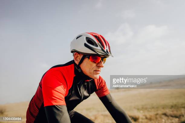 portrait of a senior cyclist - cycling helmet stock pictures, royalty-free photos & images