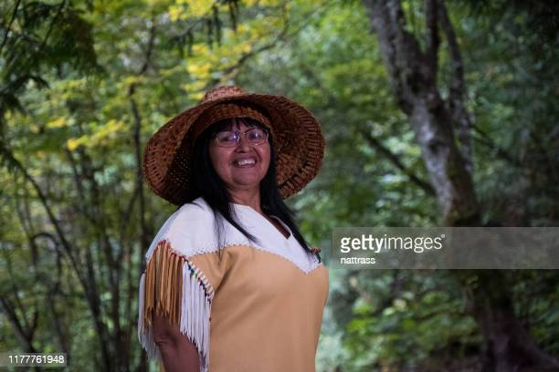 portrait of a senior indigenous canadian woman - inuit canada stock pictures, royalty-free photos & images