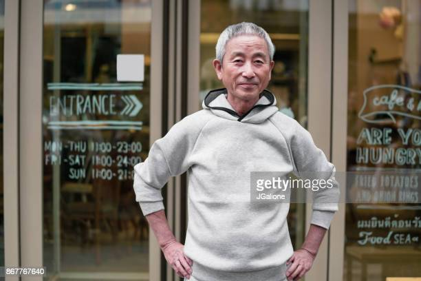 portrait of a senior japanese man - jgalione stock pictures, royalty-free photos & images