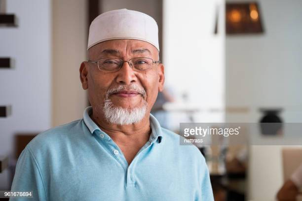 portrait of a senior malaysian man - islam stock pictures, royalty-free photos & images