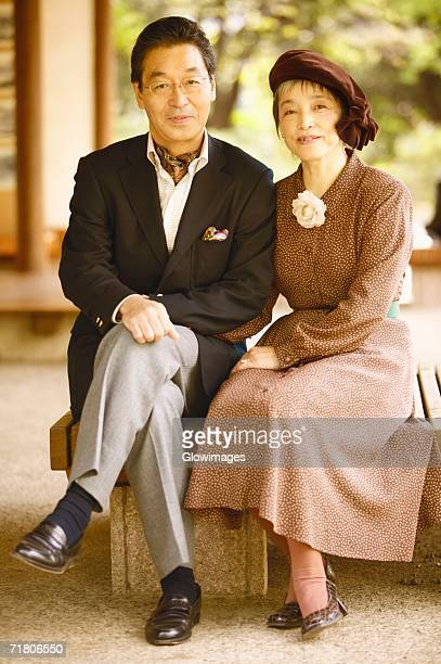 portrait of a senior man and a mature woman sitting together - cravat stock pictures, royalty-free photos & images