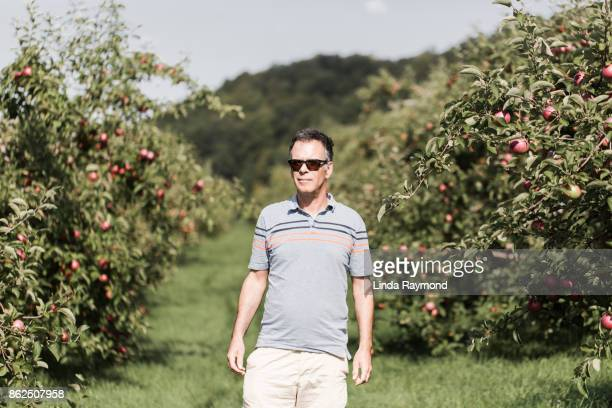 Portrait of a senior man in a orchard