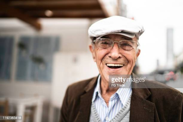 portrait of a senior man in the street - senior men stock pictures, royalty-free photos & images