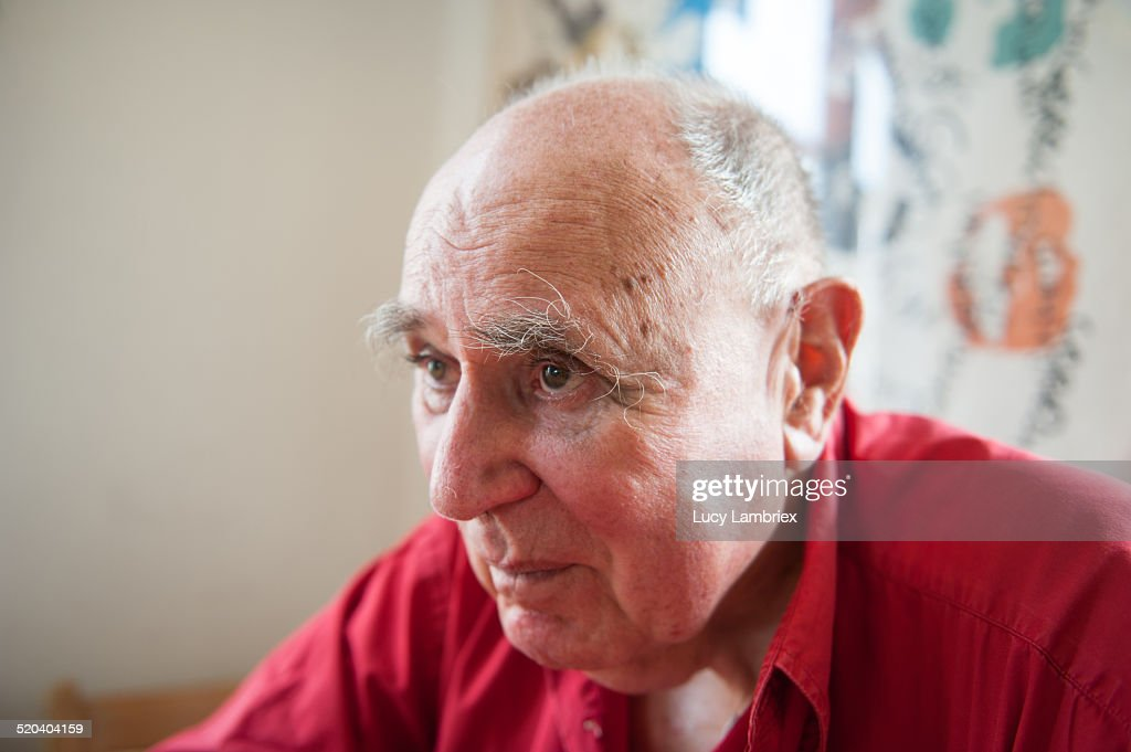 Portrait of a senior man looking away : Stock Photo