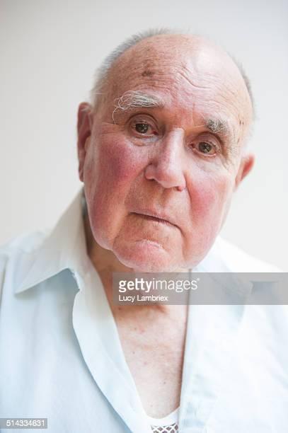 Portrait of a senior man, looking somewhat sad
