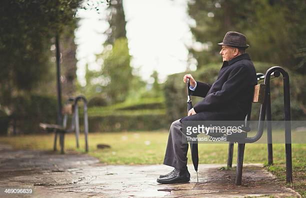 portrait of a senior man - bench stock pictures, royalty-free photos & images