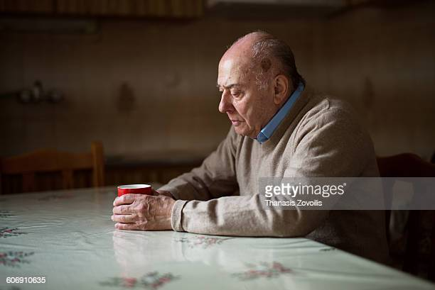 portrait of a senior man - loneliness stock pictures, royalty-free photos & images