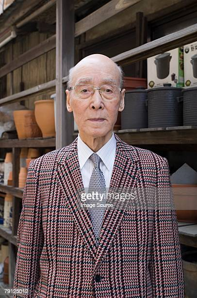 portrait of a senior man - checked suit stock pictures, royalty-free photos & images