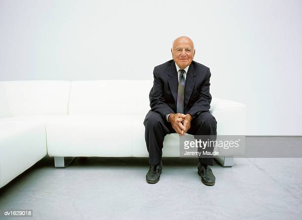 Portrait of A Senior Man Sitting on a Sofa