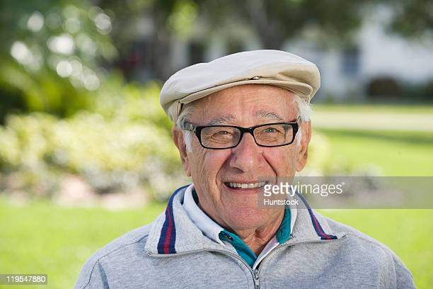 portrait of a senior man smiling - flat cap stock pictures, royalty-free photos & images