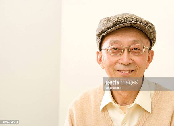 portrait of a senior man smiling - flat cap stock photos and pictures