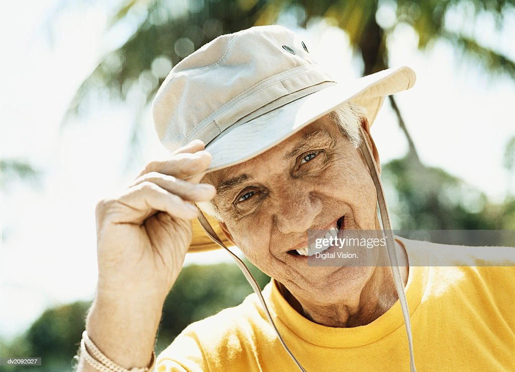 Portrait of a Senior Man Wearing a Sun Hat : Stock Photo