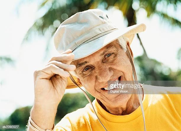 Portrait of a Senior Man Wearing a Sun Hat