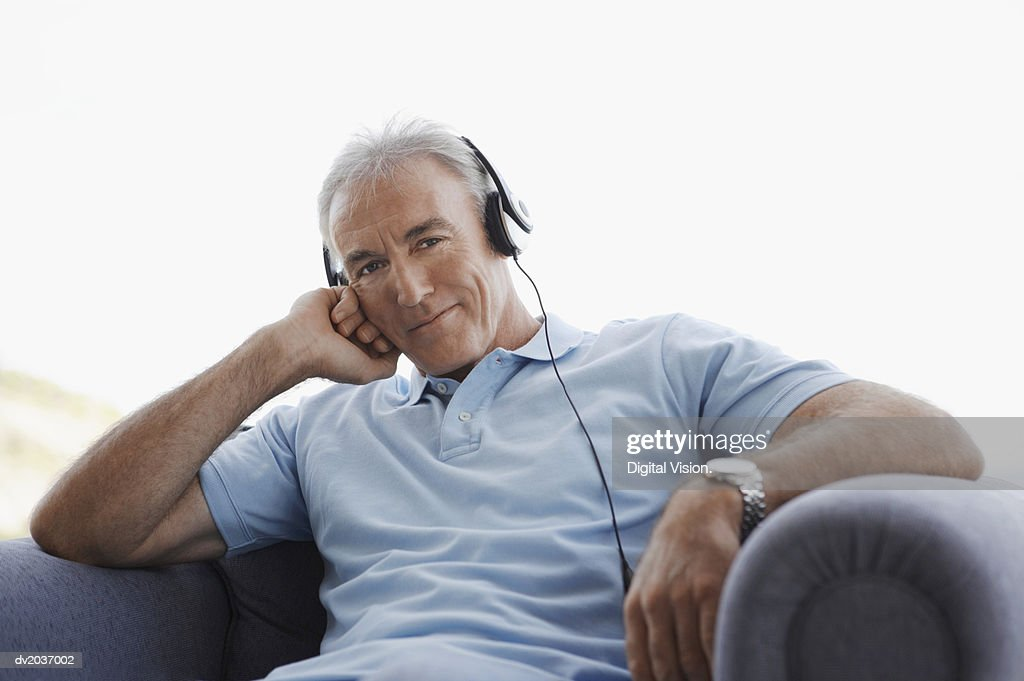 Portrait of a Senior Man Wearing Headphones : Stock Photo