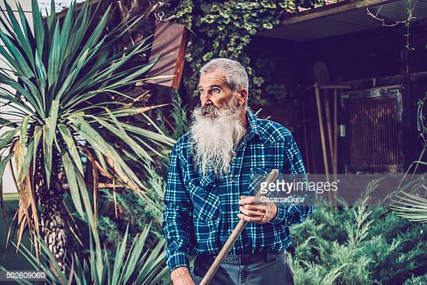 Portrait of a Senior Man with Extremely Long Beard Outdoors