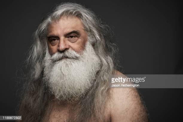 a portrait of a senior man with long grey hair and a white beard - jason wise stock pictures, royalty-free photos & images