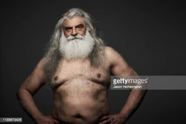a portrait of a senior man with long grey hair and a white beard with a serious stare - jason wise stock pictures, royalty-free photos & images