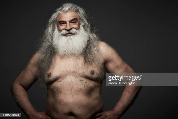 a portrait of a senior man with long grey hair and a white beard with a fun expression - jason wise stock pictures, royalty-free photos & images