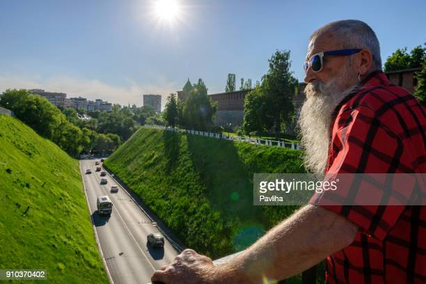 portrait of a senior man with white beard traveling on the volga river in russia - nizhny novgorod oblast stock photos and pictures