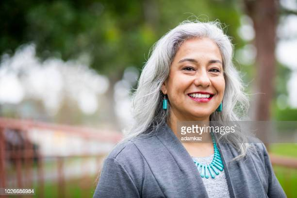 portrait of a senior mexican female administrator - mature adult stock pictures, royalty-free photos & images