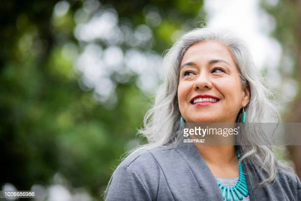 portrait of a senior mexican female administrator - chubby stock pictures, royalty-free photos & images