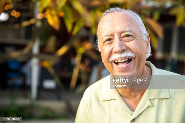 portrait of a senior mexican man smiling - only senior men stock pictures, royalty-free photos & images
