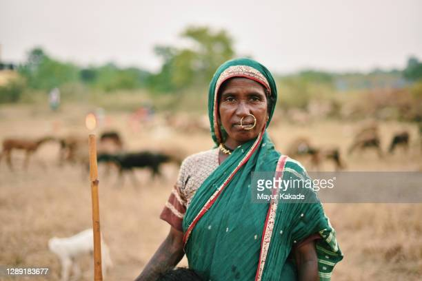 portrait of a senior shepherd woman who lives nomadic life - minority groups stock pictures, royalty-free photos & images