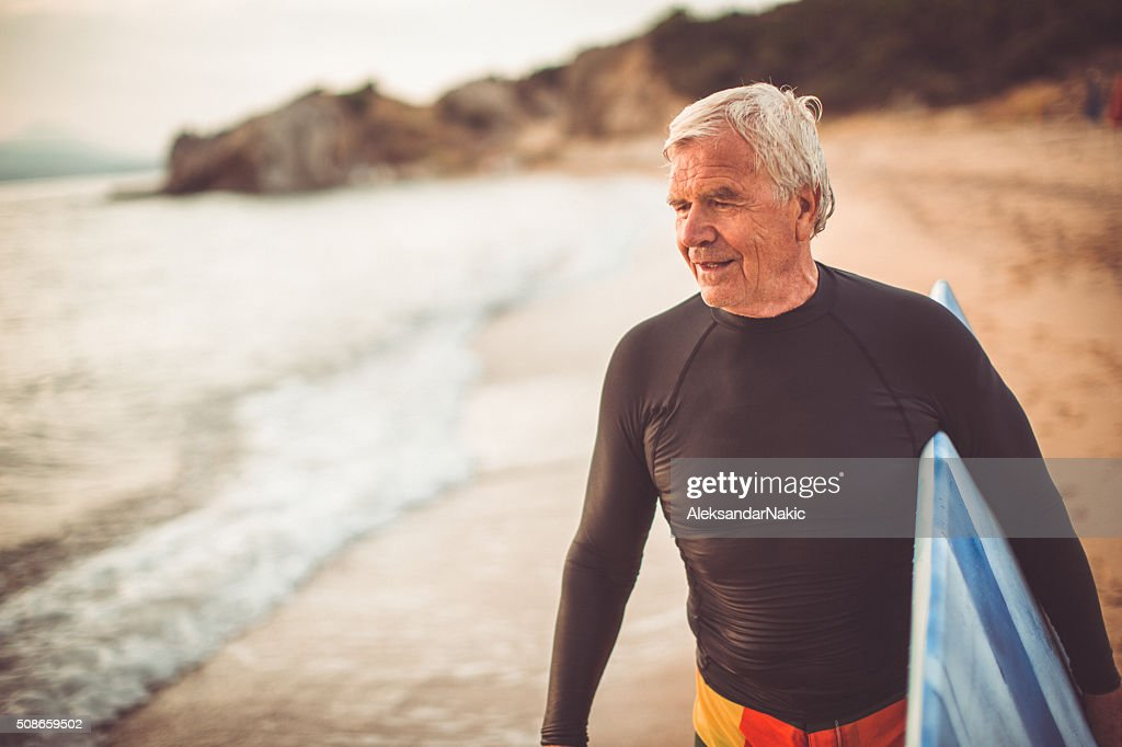 Portrait of a senior surfer : Stock Photo