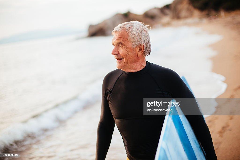 Portrait of a senior surfer : Stock Photo