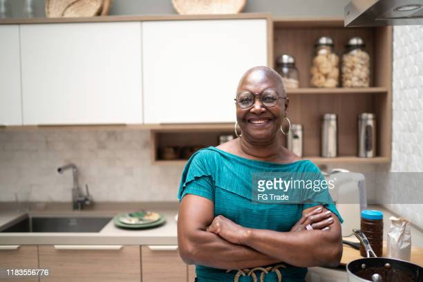 portrait of a senior woman at home - pardo brazilian stock pictures, royalty-free photos & images