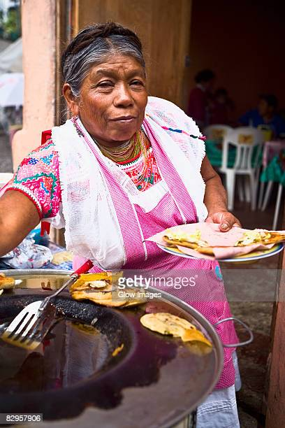 portrait of a senior woman holding a plate of mexican food, cuetzalan, puebla state, mexico - puebla mexico stock pictures, royalty-free photos & images
