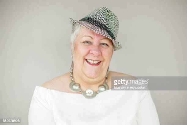 a portrait of a senior woman in her 60's - fedora stock pictures, royalty-free photos & images