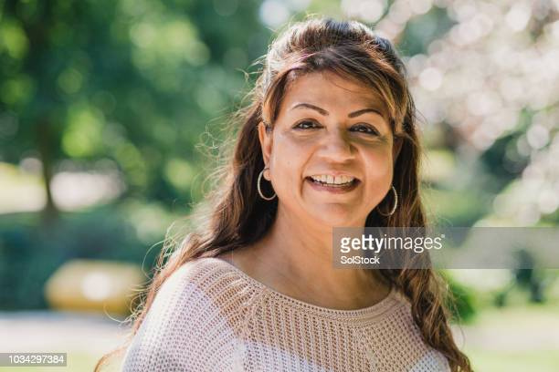 portrait of a senior woman - asian 50 to 55 years old woman stock photos and pictures