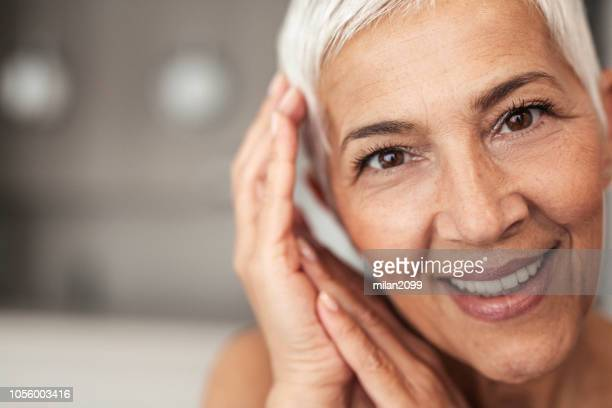 portrait of a senior woman - only mature women stock pictures, royalty-free photos & images