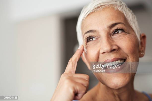portrait of a senior woman - wrinkled stock pictures, royalty-free photos & images