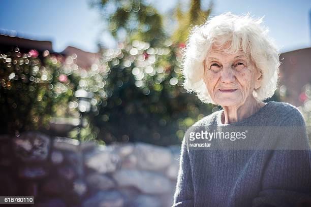 Portrait of a senior woman sitting in the back yard
