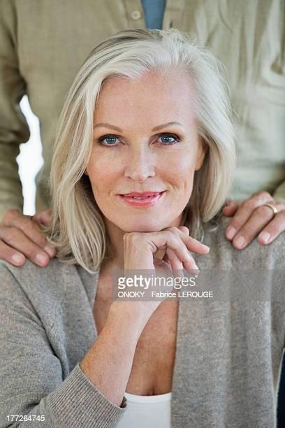 portrait of a senior woman smiling - onoky stock-fotos und bilder