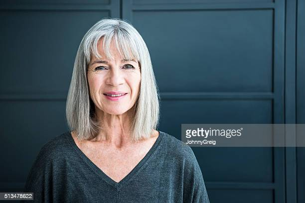 portrait of a senior woman smiling towards camera - 60 64 years stock pictures, royalty-free photos & images