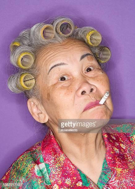 Portrait of a senior woman smoking a cigarette