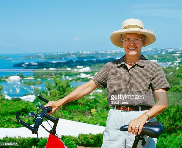 Portrait of a senior woman standing with her bicycle, Bermuda