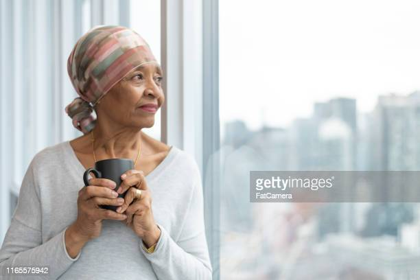 portrait of a senior woman with cancer - headwear stock pictures, royalty-free photos & images