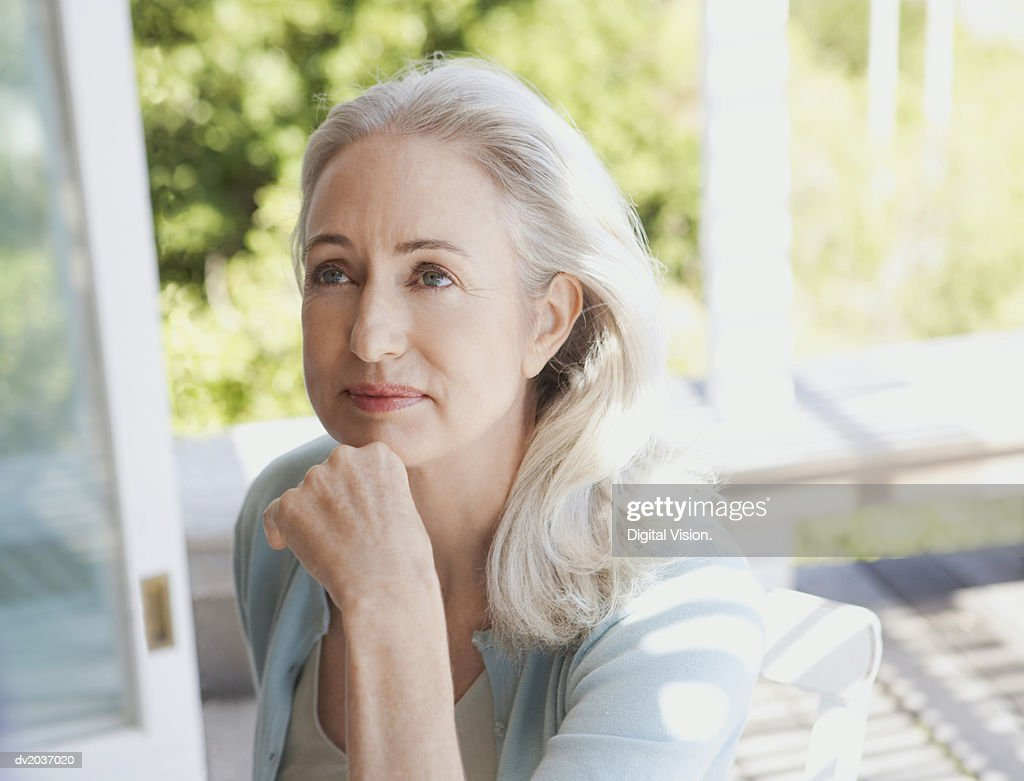 Portrait of a Senior Woman with Her Hand on Her Chin : Stock Photo