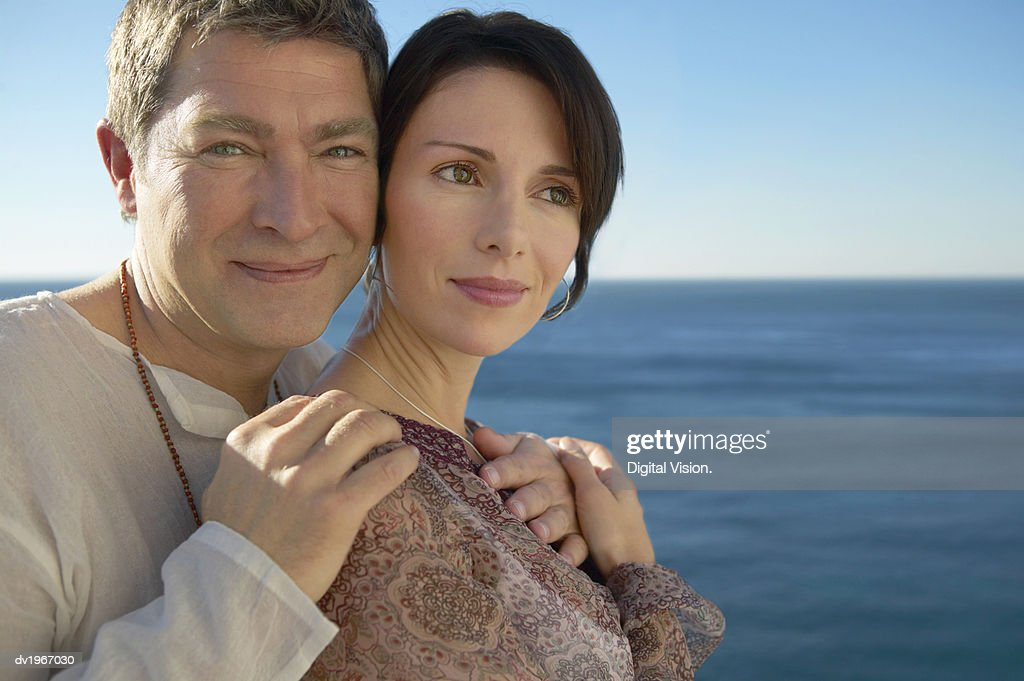 Portrait of a Serene Couple by the Sea : Stock Photo