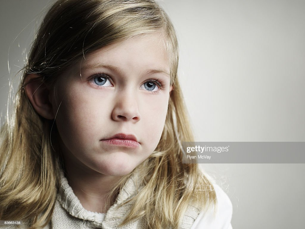 Portrait of a serious 5 year old girl. : Stock Photo